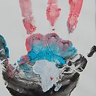 Red, Blue, and Black Handprint by The Street Child Project