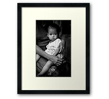 Mothers care in the slums of Manila Framed Print