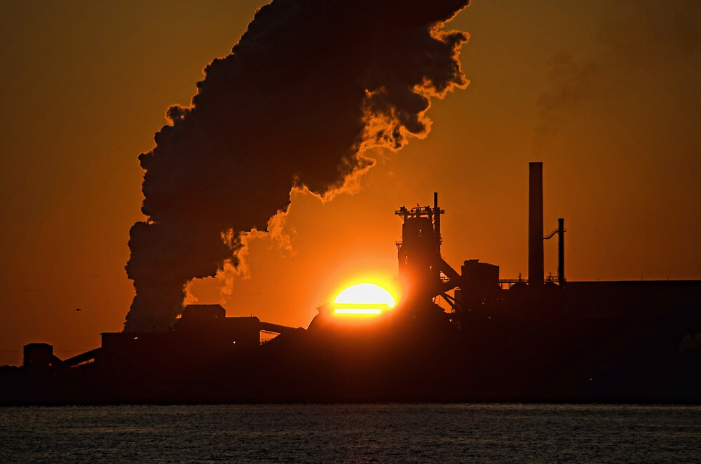 Sunrise over Stelco by Bill  Watson