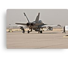 F/A 18 Being Loaded with Ordanance Before Take-Off Canvas Print