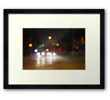 Abstract blurry spots of light in the night city street Framed Print