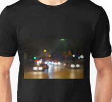 Abstract blurry spots of light in the night city street Unisex T-Shirt
