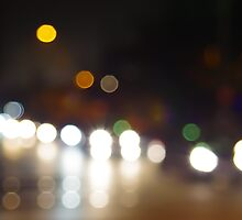 Abstract blurry spots of light in the night city street by vladromensky