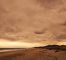 Okuru Beach clouds by Odille Esmonde-Morgan