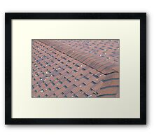 Top view of brown roof shingles with a few autumn leaves Framed Print