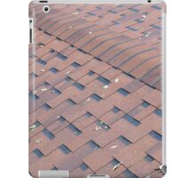 Top view of brown roof shingles with a few autumn leaves iPad Case/Skin