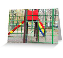 Empty children's playground and a slide in the park Greeting Card