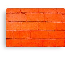 Red background of bricks with a layer of paint close-up Canvas Print