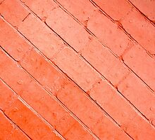 Red background of bricks on a diagonal image with a layer of paint by vladromensky