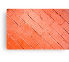 Red background of bricks on a diagonal image with a layer of paint Canvas Print