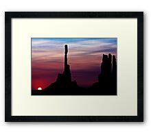 Sun dawns at Totem Pole Framed Print