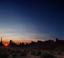 Moon watches sun rise at Totem Pole by Owed To Nature
