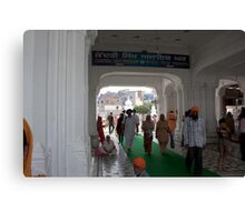 Devotees entering the Golden Temple in Amritsar Canvas Print