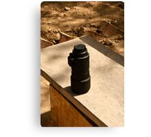 Nikon zoom lens on a stone bench Canvas Print