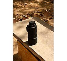 Nikon zoom lens on a stone bench Photographic Print