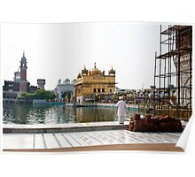 Praying at the edge of the pond inside the Golden Temple Poster