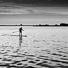 Lone paddler on Lake Veere. by M. van Oostrum