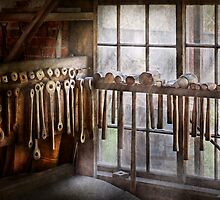 Black Smith - Draw plates and hammers  by Mike  Savad