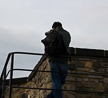 Tourist taking photos inside Edinburgh Castle by ashishagarwal74