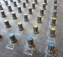 closeup on a sliders of a mixing console by noegrr