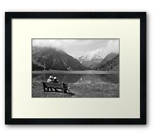 Conversation on a bench Framed Print