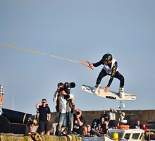 Wake-boarding Over The Harbour Wall At Lyme, Dorset by lynn carter