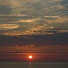 Boat passing through sunset by Elizabeth Carpenter