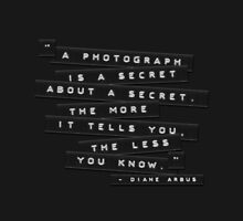 A Photograph Is A Secret Embossed Labels by Brian Carson