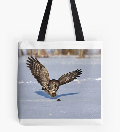Great Grey owl catches a mouse Tote Bag