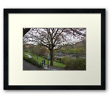 Couple walking on a wet path in Edinburgh near the Train Station Framed Print