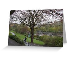 Couple walking on a wet path in Edinburgh near the Train Station Greeting Card