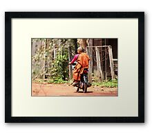 Monk on a Moped Framed Print