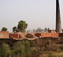 Brick kiln and pile of bricks by ashishagarwal74
