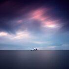Island at dusk by yurybird