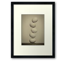 Balancing Eggs Framed Print