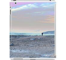 man walking at rocky beach iPad Case/Skin