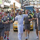 Carlton Dixon with the Olympic Torch In Bromley by Keith Larby