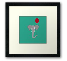 Elephant head with red balloon Framed Print