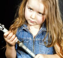 Cute little girl with gas spanner in her hands Sticker