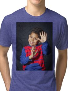 Emotional little black afro-american boy posing in studio Tri-blend T-Shirt