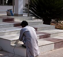Worker giving finishing touches to the marble stairs by ashishagarwal74