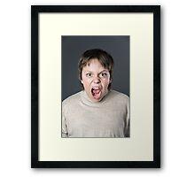 Teenage boy emotion portrait. Isolated on grey background. Framed Print