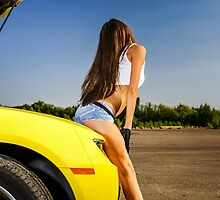 Luxury glamour girl posing with yellow sport car by Alexander Sorokopud