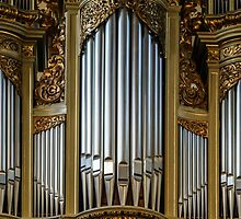 Beautiful old organ decorated by gold in the village church by Alexander Sorokopud