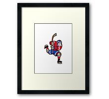 Ice Hockey Player Striking Stick Framed Print