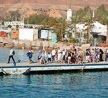 Tourists waiting to climb onto dive and snorkeling boats at Sharm El Sheikh by ashishagarwal74