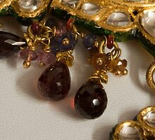 3 hanging semi-precious stones attached to a green and gold necklace by ashishagarwal74