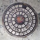 Sewer inspection cover. ( Alcantarillado.) by John  Smith