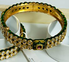 Beautiful green and purple covered gold bangles with semi-precious stones inlaid by ashishagarwal74