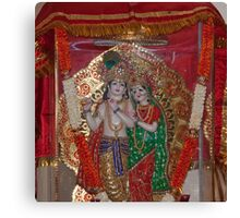 Statue of Lord Krishna and Radha inside a glass case with a cloth cover Canvas Print